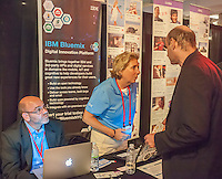 A rep from IBM Bluemix explains their services at the Techweek expo in New York event on Thursday, October 15, 2015. Thousands of visionaries and entrepreneurs attended to network with established and start-up technology companies. (© Richard B. Levine)