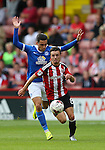Stefan Scougall of Sheffield Utd gets past Callum Chettle of Peterborough Utd during the League One match at Bramall Lane Stadium, Sheffield. Picture date: September 17th, 2016. Pic Simon Bellis/Sportimage