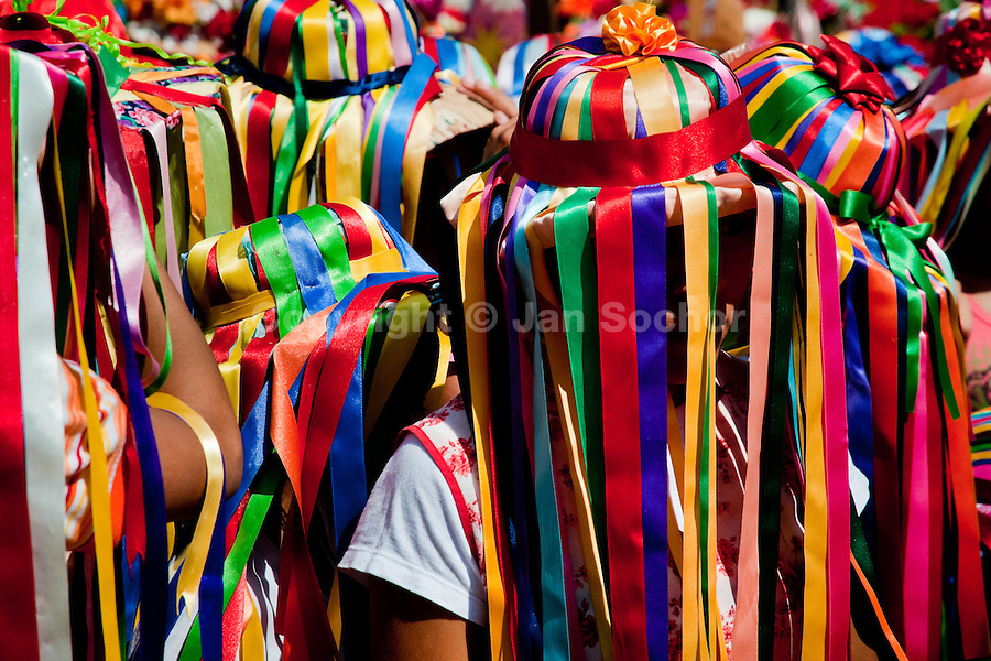 "A Negritas dancer with colorful ribbons on a hat takes part in the religious procession in Atanquez, Sierra Nevada, Colombia, 3 June 2010. A colorful celebration of Corpus Christi is held in the Kankuamo Indians territory every year. ""The Dance of the Devils"" is an ancient tradition kept for centuries on the Colombia's Caribbean coast. This Christian religious event usually coincides with the summer solstice, which has always been the key point for the native cultures and for the black African slaves. Due to this confluence, the Kankuamo myths, the African animistic rites and other Pre-Columbian features have blended with the Spanish Catholic festival into a lively spectacle."