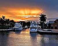 Sunset provides a dramatic setting to the yachts and mansions that line the Fort Lauderdale, Florida waterways.