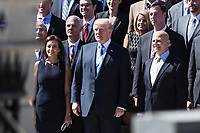 United States President Donald J. Trump poses for a group photo with a group of National Security Council staff members on the steps of the Eisenhower Executive Office Building in Washington, DC on Thursday, September 28, 2017.  Pictured with the President are Dina Powell, Deputy National Security Advisor for Strategy, left, and H.R. McMaster, National Security Advisor, right.<br /> Credit: Alex Edelman / CNP /MediaPunch