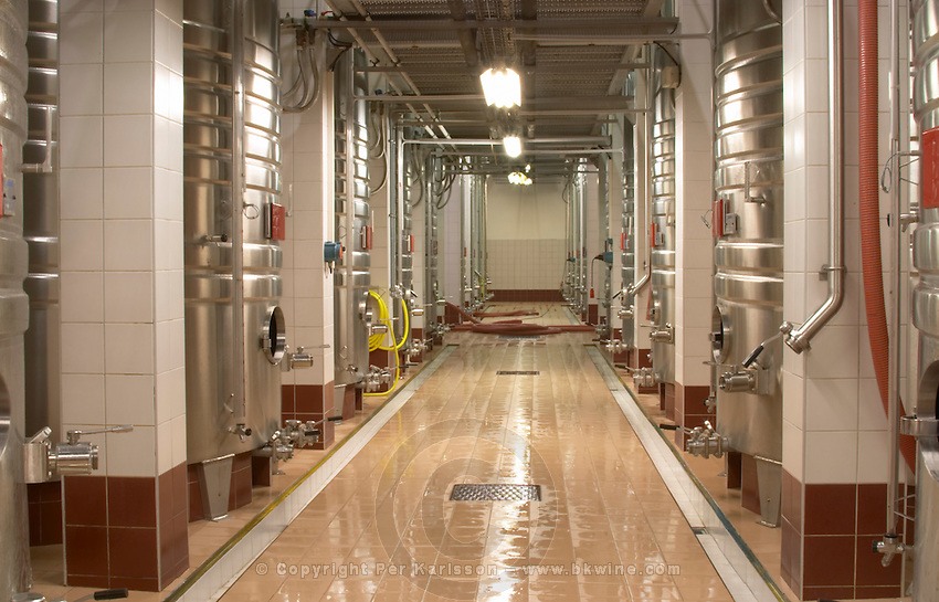 Rows of stainless steel fermentation tanks and a newly cleaned floor. The winery is designed and the wine making follows Feng-Shui principles which according to their empirical experiences make a better wine Champagne Duval Leroy, Vertus, Cotes des Blancs, Champagne, Marne, Ardennes, France