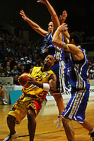 Brendon Polybank and Arthur Polybank try to block Brian Wethers during game two of the NBL Final basketball match between the Wellington Saints and Waikato Pistons at TSB Bank Arena, Wellington, New Zealand on Friday 20 June 2008. Photo: Dave Lintott / lintottphoto.co.nz