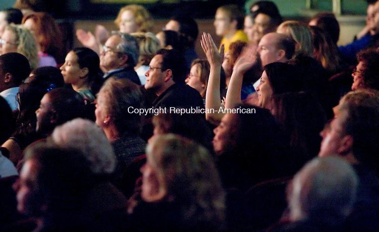 WATERBURY, CT- 19 OCT 2007- 101907JT06- <br /> A spectator applauds Tito Puente, Jr. during his performance the Palace Theater in Waterbury on Friday.<br /> Josalee Thrift / Republican-American