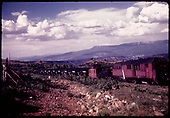 Train with stock cars, caboose #0400, tender and rotary possibly in Dallas Divide area.<br /> RGS  Dallas Divide area ?, CO