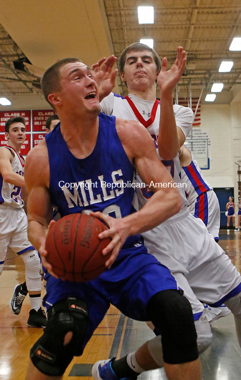 Woodbury, CT 122216MK11 Lewis Mills' Trevor Baker drives as Nonnewaug's James Gengenbach defends during Berkshire League action at Nonnewaug High School Thursday night.  Lewis Mills defeated Nonnewaug. (EDITORS NOTE LEFT WITH 1:55 LEFT IN GAME LM 78 N49.) Michael Kabelka / Republican-American