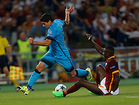 Barcellona's Luis Suarez fight for the ball with  AS Roma's Antonio Rudiger   during the Champions League Group E soccer match   at the Olympic Stadium in Rome September 16, 2015