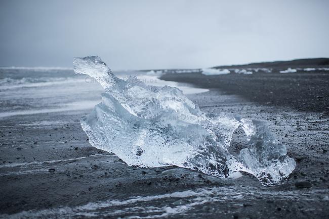 Ice from the Breidamerkurjoekull glacier. The ice floats from the glacier into the North Atlantic. This piece of ice looks like a dragon.<br /> Eis vom Breidamerkurjoekull-Gletscher am Meeresstrand. Das Eis treibt vom Gletscher mit dem Schmelzwasser in den Nordatlantik. Dieses Stueck Gletschereis hat die Form eines Drachens.<br /> 22.3.2016, Joekulsarlon<br /> Copyright: Christian-Ditsch.de<br /> [Inhaltsveraendernde Manipulation des Fotos nur nach ausdruecklicher Genehmigung des Fotografen. Vereinbarungen ueber Abtretung von Persoenlichkeitsrechten/Model Release der abgebildeten Person/Personen liegen nicht vor. NO MODEL RELEASE! Nur fuer Redaktionelle Zwecke. Don't publish without copyright Christian-Ditsch.de, Veroeffentlichung nur mit Fotografennennung, sowie gegen Honorar, MwSt. und Beleg. Konto: I N G - D i B a, IBAN DE58500105175400192269, BIC INGDDEFFXXX, Kontakt: post@christian-ditsch.de<br /> Bei der Bearbeitung der Dateiinformationen darf die Urheberkennzeichnung in den EXIF- und  IPTC-Daten nicht entfernt werden, diese sind in digitalen Medien nach &sect;95c UrhG rechtlich geschuetzt. Der Urhebervermerk wird gemaess &sect;13 UrhG verlangt.]