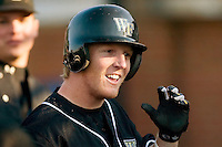 Wake Forest right fielder Willy Fox is all smiles as he returns to the dugout following his 2nd home run on the day versus Virginia at Gene Hooks Stadium in Winston-Salem, NC, Friday, March 9, 2007.  The Demon Deacons upset the #4 Cavaliers 8-3.
