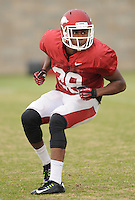 NWA Media/ANDY SHUPE - Arkansas safety Josh Liddell works through drills during practice Saturday, Dec. 13, 2014, at the university's practice facility in Fayetteville.