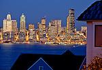 Seattle, Washington<br /> Dusk on Elliott Bay with the Seattle city skyline glowing in reflected light, from a West Seattle neighborhood