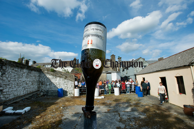 A bottle target all set to be broken at the World Stone Throwing Championships in Corofin. Photograph by John Kelly.