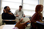 Greg Wahl, center, associate professor at Montgomery College, works with Dominique Parrish, a student in his Basic Writing II class, as she started working on her final project. If students pass this class, it allows them to progress to the college level english program. Otherwise students will face the decision to take the remedial class again or drop out.
