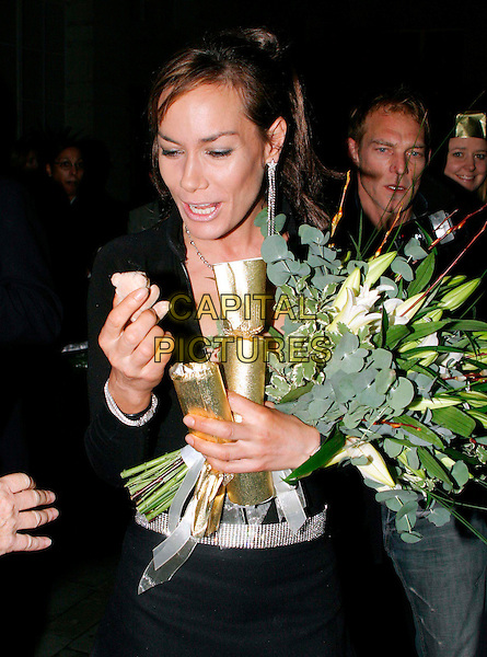 TARA PALMER TOMKINSON.lights the first ever Christmas tree at the Renaissance Chancery Court hotel.19/11/2003.flowers, bouquet, present, teddy bear, funny.www.capitalpictures.com.sales@capitalpictures.com.© Capital Pictures.