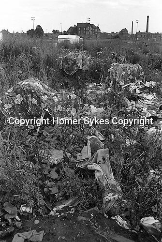 Gypsy inner city camp site Balsall Heath Birmingham UK 1968. Blankets and towell foreground hanging out to dry amongst rubbish.