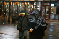 EXCHANGE PLACE, NJ - JANUARY 29: A man try to hold his umbrella as people commute New York - New Jersey on January 29, 2019 in Exchange Place, New Jersey. Government officials urged New York to prepare for snow and cold temperatures on the state. the National Weather Service has issued flooding and winter weather warnings and advisories for different areas of the state. (Photo by Eduardo MunozAlvarez/VIEWpress)