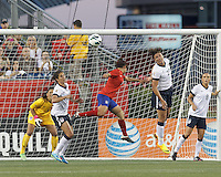 USWNT substitute forward Abby Wambach (20) heads ball clear on corner kick. USWNT substitute goalkeeper Hope Solo (1), USWNT midfielder Carli Lloyd (10), and Korea Republic midfielder Cho Sohyun (8). In an international friendly, the U.S. Women's National Team (USWNT) (white/blue) defeated Korea Republic (South Korea) (red/blue), 4-1, at Gillette Stadium on June 15, 2013.