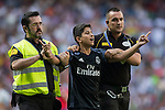 Security guards escort a young fan who invaded the pitch to greet Karim Benzema of Real Madrid during the La Liga match between Real Madrid and Osasuna at the Santiago Bernabeu Stadium on 10 September 2016 in Madrid, Spain. Photo by Diego Gonzalez Souto / Power Sport Images