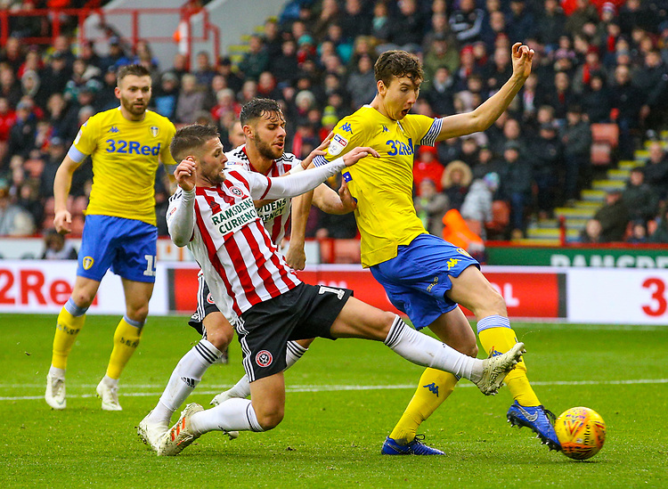 Leeds United's Aapo Halme shoots under pressure from Sheffield United's Oliver Norwood<br /> <br /> Photographer Alex Dodd/CameraSport<br /> <br /> The EFL Sky Bet Championship - Sheffield United v Leeds United - Saturday 1st December 2018 - Bramall Lane - Sheffield<br /> <br /> World Copyright © 2018 CameraSport. All rights reserved. 43 Linden Ave. Countesthorpe. Leicester. England. LE8 5PG - Tel: +44 (0) 116 277 4147 - admin@camerasport.com - www.camerasport.com