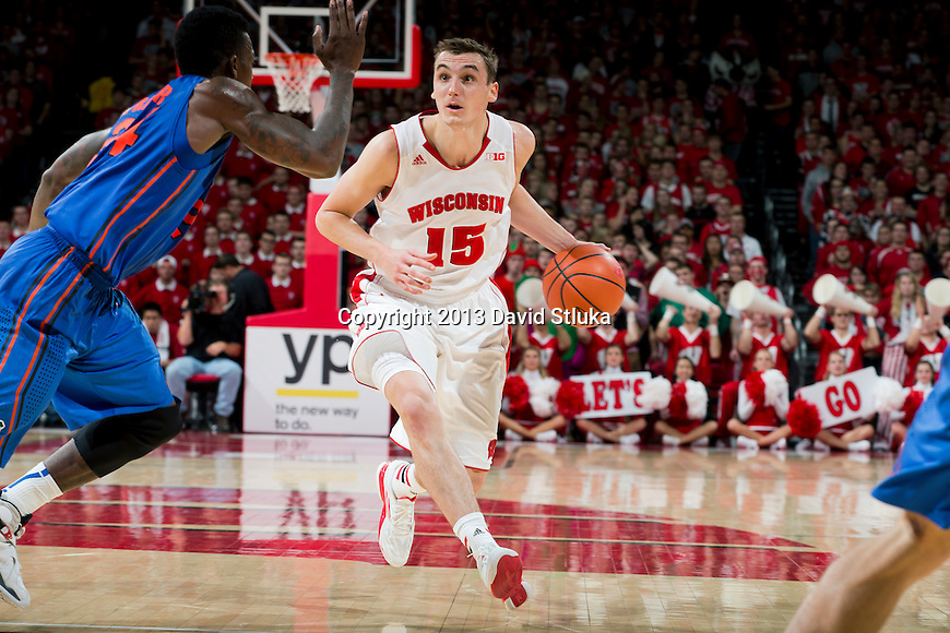 Wisconsin Badgers forward Sam Dekker (15) handles the ball against Florida Gators forward Casey Prather (24) during an NCAA college basketball game Tuesday, November 12, 2013, in Madison, Wis. The Badgers won 59-53. (Photo by David Stluka)