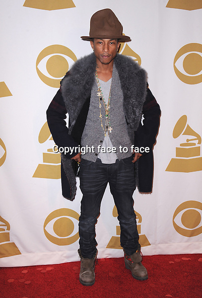 LOS ANGELES, CA - JANUARY 27:  Pharrell Williams arrives at &quot;The Night That Changed America: A Grammy Salute to The Beatles&quot; at the Los Angeles Convention Center West Hall on January 27, 2014 in Los Angeles, California. <br /> Credit: MediaPunch/face to face<br /> - Germany, Austria, Switzerland, Eastern Europe, Australia, UK, USA, Taiwan, Singapore, China, Malaysia, Thailand, Sweden, Estonia, Latvia and Lithuania rights only -