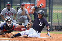 GCL Yankees 1 outfielder Leonardo Molina (18) is tagged out at home by catcher Alejandro Flores (50) during the second game of a doubleheader against the GCL Braves on July 1, 2014 at the Yankees Minor League Complex in Tampa, Florida.  GCL Braves defeated the GCL Yankees 1 by a score of 3-1.  (Mike Janes/Four Seam Images)