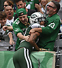 Robby Anderson #11 of the New York Jets leaps into the stands to celebrate with longtime season ticket holders Mike Chinery, right, and son Matt Chinery after catching a pass for a 76-yard touchdown in the second quarter of an NFL game against the Denver Broncos at MetLife Stadium in East Rutherford, NJ on Sunday, Oct. 7, 2018.