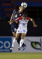 Ali Krieger of USA (left) heads the ball over Shirley Cruz of Costa Rica (R). USWNT vs Costa Rica in the 2010 CONCACAF Women's World Cup Qualifying tournament held at Estadio Quintana Roo in Cancun, Mexico on November 1st, 2010.