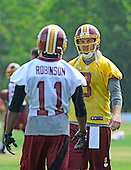 Washington Redskins reserve quarterback Rex Grossman (8) and wide receiver Aldrick Robinson (11) discuss their assignments as they participate in passing drills during the 2013 minicamp at Redskins Park in Ashburn, Virginia on Wednesday, June 12, 2013.<br /> Credit: Ron Sachs / CNP