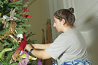 OrigamiUSA artists preparing the models and designing the Holiday Tree at the American Museum of Natural History. Alice at work.