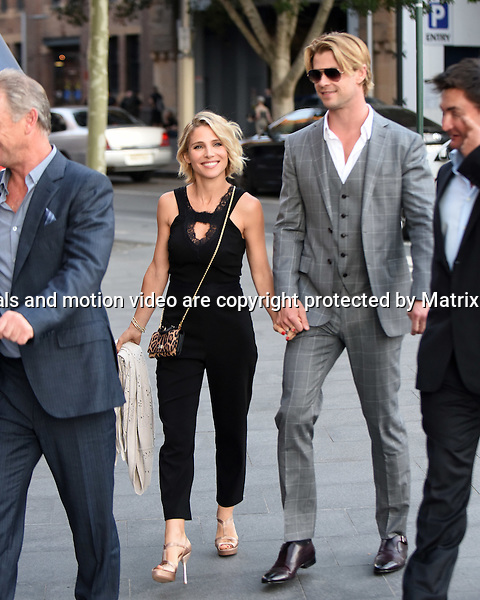 30th October, 2014 SYDNEY AUSTRALIA<br /> Non EXCLUSIVE <br /> Pictured, Chris Hemsworth and wife, Elsa Pataky leaving the Sydney Theater at Walsh Bay with a group of executives heading for a water taxi to take them to dinner on Sydney Harbour, NSW. <br /> <br /> *No internet without clearance*.MUST CALL PRIOR TO USE +61 2 9211-1088. Matrix Media Group.Note: All editorial images subject to the following: For editorial use only. Additional clearance required for commercial, wireless, internet or promotional use.Images may not be altered or modified. Matrix Media Group makes no representations or warranties regarding names, trademarks or logos appearing in the images.