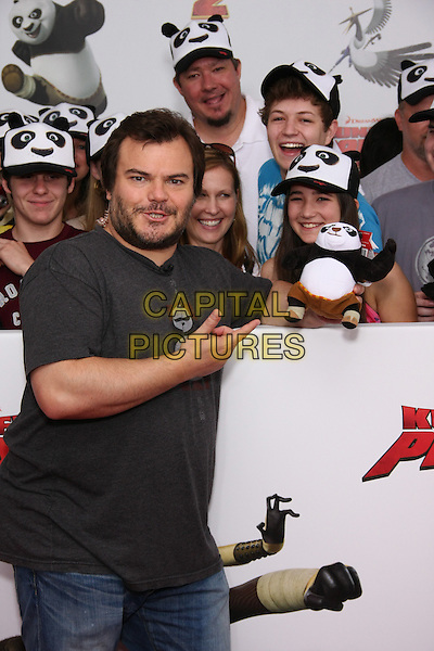 "JACK BLACK.The New York Premiere of ""Kung Fu Panda 2"" at the Ziegfeld Theatre, New York, NY, USA. .May 24th, 2011.half length jeans denim black t-shirt  beard facial hair fans crowd audience hand pointing stuffed toy .CAP/LNC/TOM.©TOM/LNC/Capital Pictures."