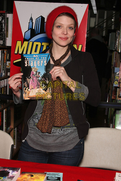 "AMBER BENSON.at the Book Signing for ""Cat's Claw"" at Midtown Comics Times Square, New York, NY, USA, .February 27th, 2010..half length brown scarf  black grey gray top red hat beanie jacket holding .CAP/LNC/TOM.©LNC/Capital Pictures"
