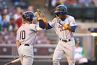 Vidal Brujan (2) of the Bowling Green Hot Rods high fives teammate Taylor Walls (10) after leading off the game with a home run against the Dayton Dragons at Fifth Third Field on June 8, 2018 in Dayton, Ohio. The Hot Rods defeated the Dragons 11-4.  (Brian Westerholt/Four Seam Images)