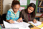 Public High School public two female students working together