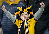 5th February 2019, Molineux Stadium, Wolverhampton, England; FA Cup football, 4th round replay, Wolverhampton Wanderers versus Shrewsbury Town; A young Wolves supporter wearing a team shirt and scarf and a joker hat in the stands before the kick off