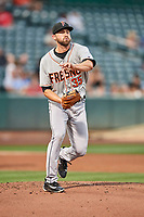 Fresno Grizzlies starting pitcher Kent Emanuel (35) throws to first base against the Salt Lake Bees  at Smith's Ballpark on September 3, 2017 in Salt Lake City, Utah. The Bees defeated the Grizzlies 10-8. (Stephen Smith/Four Seam Images)