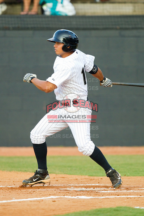 Jeffer Patino #15 of the Bristol White Sox follows through on his swing against the Bluefield Orioles at Boyce Cox Field August 27, 2010, in Bristol, Tennessee.  Photo by Brian Westerholt / Four Seam Images
