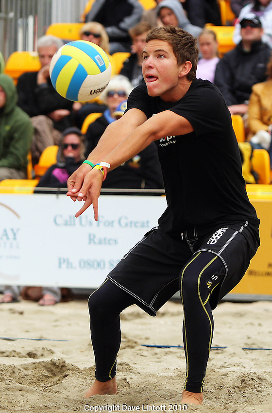 Edwin O'Dea bumps in the men's final..2009 McEntee Hire NZ Beach Volleyball Tour stage two at Oriental Parade, Wellington. Sunday, 10 January 2010. Photo: Dave Lintott/lintottphoto.co.nz