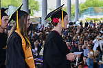 Graduates wait on stage for their diplomas during the 2015 Western Nevada College Commencement held at the Pony Express Pavilion in Carson City, Nev., on Monday, May 18, 2015.<br /> Photo by Tim Dunn