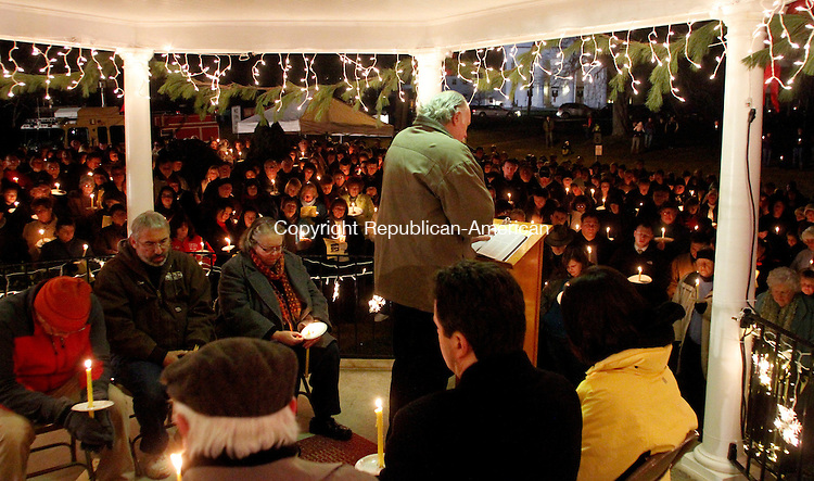 WATERTOWN, CT.- 15 DECEMBER 2012 - 121512JW05 - Fellow members of the clergy and town members listen to Reverend Paul Hibbard of the Watertown United Methodist Church during a prayer vigil for the victims of the Sandy Hook Elementary School shootings at the Watertown Gazebo Saturday evening..Jonathan Wilcox Republican American