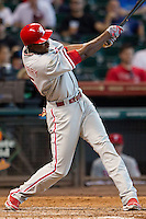 Philadelphia Phillies outfielder John Mayberry #15 swings during the Major League baseball game against the Houston Astros on September 16th, 2012 at Minute Maid Park in Houston, Texas. The Astros defeated the Phillies 7-6. (Andrew Woolley/Four Seam Images).
