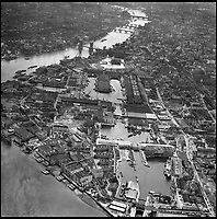 BNPS.co.uk (01202 558833)<br /> Pic: Aerofilms/HistoricEngland/BNPS<br /> <br /> Pool of London, 3 May 1963.<br /> <br /> Stunning historic aerial photos of seaside towns, naval bases, ports and shipyards which tell the story of Britain's once-great maritime tradition feature in a new book.<br /> <br /> The fascinating archive of black and white images includes views from a bygone age such as Brighton's famous West Pier, Grimsby's burgeoning fishing fleet, and London's dock yards.<br /> <br /> Iconic ships were also captured from the skies including the Cutty Sark in its final seaworthy years on the Thames, HMY Britannia in 1959, the RMS Queen Mary in 1946 and the SS Queen Elizabeth in 1969 about to make her maiden voyage.<br /> <br /> England's Maritime Heritage from the Air, by Peter Waller, is published by English Heritage and costs &pound;35.