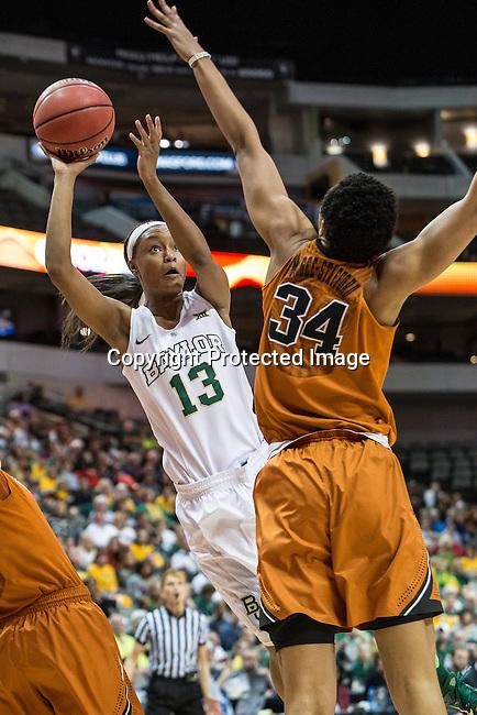 center Imani McGee-Stafford (34)  defends forward Nina Davis (13) during Big 12 women's basketball championship final, Sunday, March 08, 2015 in Dallas, Tex. (Dan Wozniak/TFV Media via AP Images)