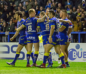 23rd March 2018, Halliwell Jones Stadium, Warrington, England; Betfred Super League rugby, Warrington Wolves versus Wakefield Trinity; Warrington celebrate the opening try scored by Tom Lineham (far right)