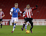 Jason McCarthy of Walsall tussles with Leon Clarke of Sheffield United during the English Football League One match at Bramall Lane, Sheffield. Picture date: November 29th, 2016. Pic Jamie Tyerman/Sportimage