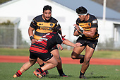 Lester Sefo looks to avoid Darryl Hemopo. Counties Manukau Premier Club Rugby game between Papakura and Bombay, played at Massey Park Papakura on Saturday June 16th 2018. Bombay won the game 36 - 17 after leading 17 - 7 at halftime.<br /> Papakura Ray White 17 - Kris Smithson 2, Taafaga Tagaloa tries, Monty Punatai conversion.<br /> Bombay 36 - Jordan Goldsmith, Haamiora Clarke 2, Patrick Masoe, Mitchell Thackham, Chay Mackwood tries, Jordan Goldsmith 2, Ki<br /> Anufe conversions.<br /> Photo by Richard Spranger.