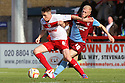 Greg Tansey of Stevenage tussles with Mike Grella of Scunthorpe.  Stevenage v Scunthorpe United - npower League 1 -  Lamex Stadium, Stevenage - 6th October, 2012. © Kevin Coleman 2012