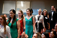 Contestants walk in a processional into Auer Hall during the opening ceremony of the 11th USA International Harp Competition at Indiana University in Bloomington, Indiana on Wednesday, July 3, 2019. (Photo by James Brosher)