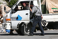 Photographer: Rick Findler..27.04.12 A member of the Free Syrian Army checks a car at a check point in the Northern region of Syria.